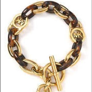 Micheal Kors gold and tortoise chain link bracelet
